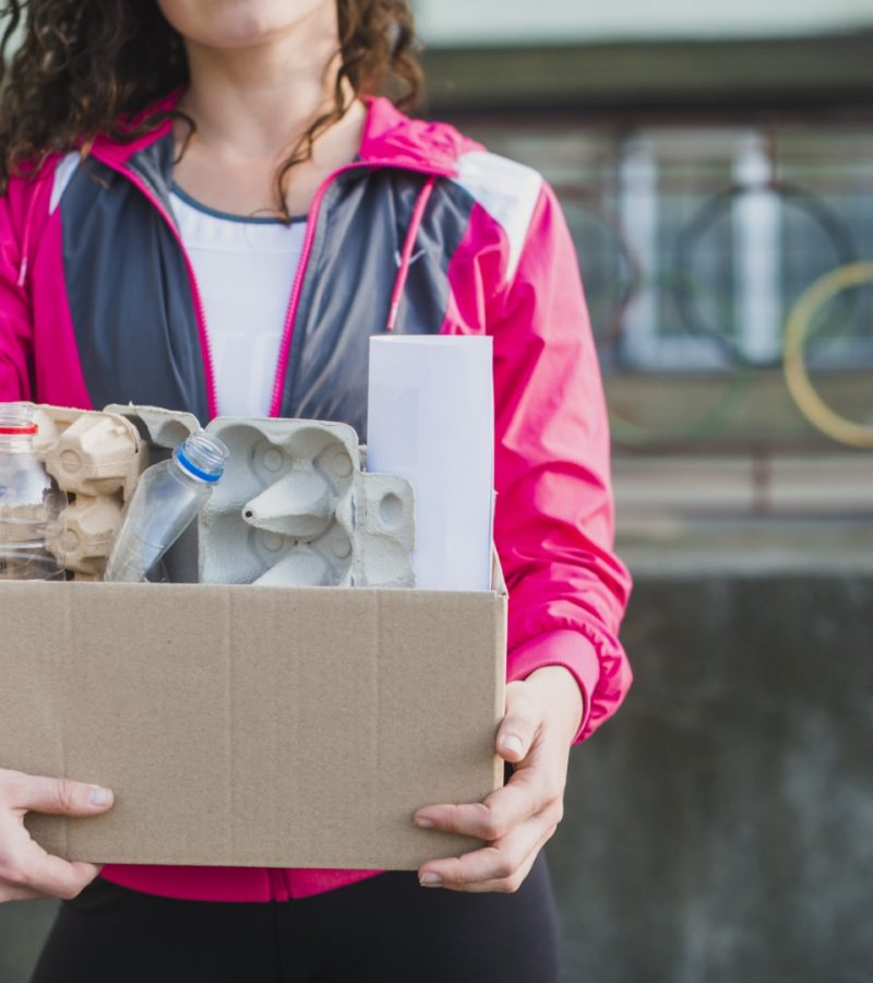 close-up-woman-holding-recycle-cardboard-box
